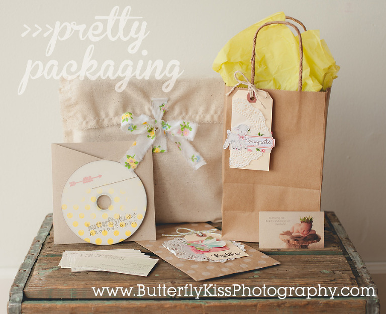 Pretty packaging tacoma newborn photographer butterfly kiss clockwise from the bottom left business cards front custom stamped disk for digital files handmade fabric album cover newborn gift bag business card reheart Gallery