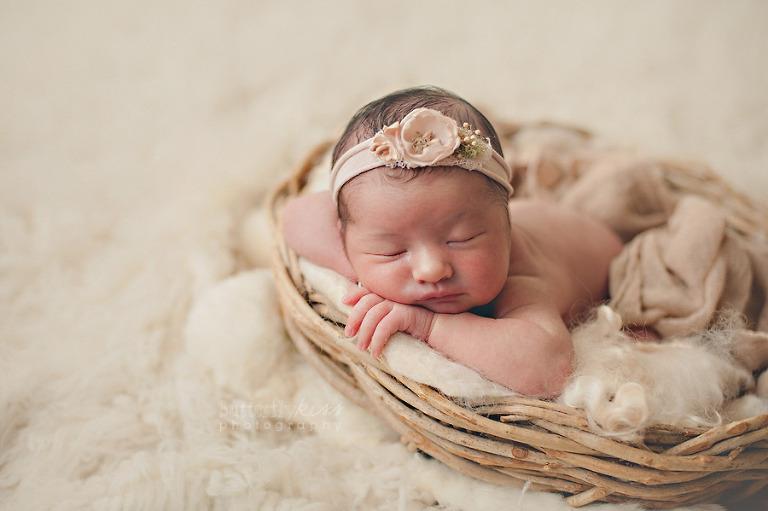 beautiful girly newborn photo with pink organic headband