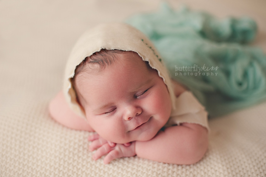 smiling happy newborn baby tacoma photographer wool soft turquoise