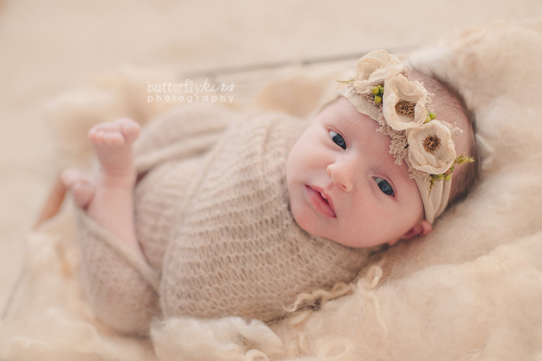 Beautiful neutral soft newborn baby picture natural floral headband awake laying wool