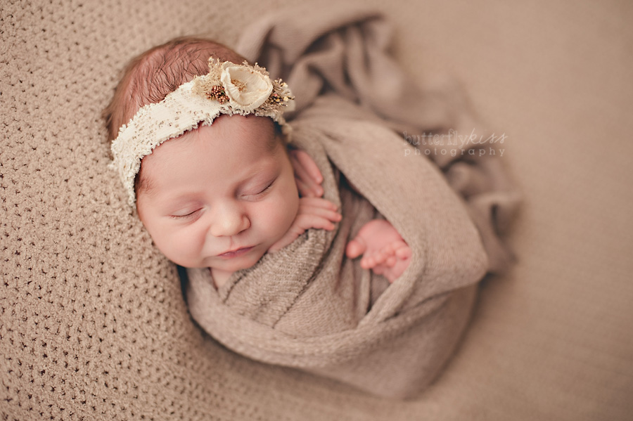 earth tone beige tan swaddles newborn baby girl with vintage upcycled white lace flower headband