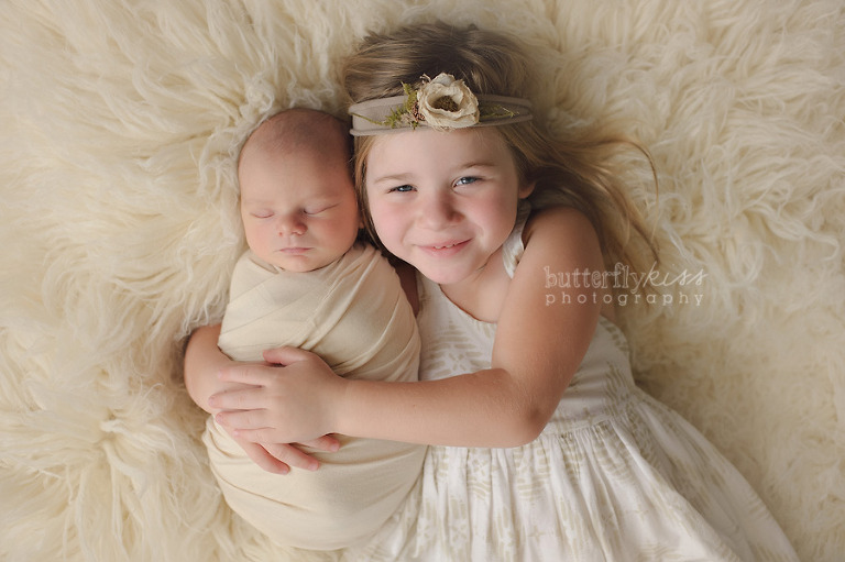 Newborn sibling mentoring creative posing wrapping styling by