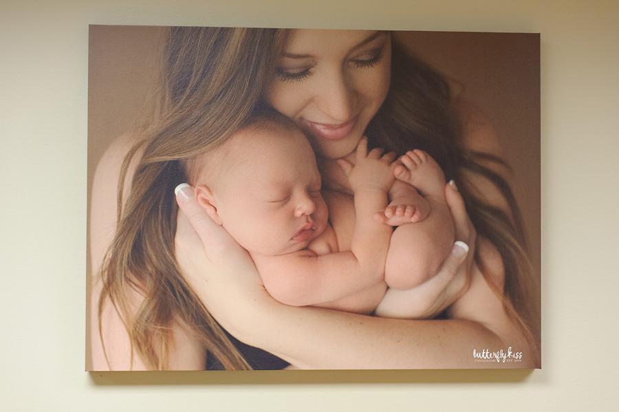Tacoma newborn photographer St Joseph Hospital mom and baby snuggles large canvas