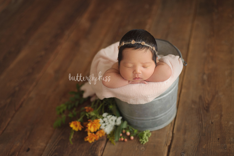 olympia newborn photographer baby girl in bucket pose with real flowers inspiration dainty floral flower headband tieback