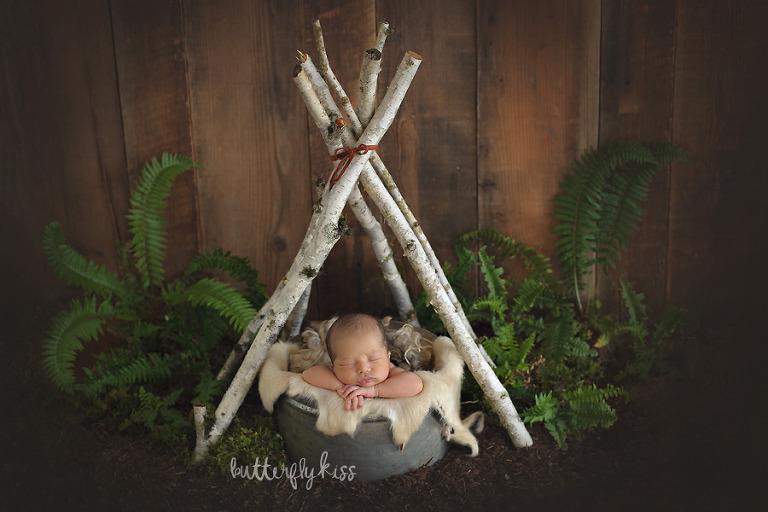 Tacoma newborn photographer baby tee pee woodland boho earthy rustic fern setup styling inspiration