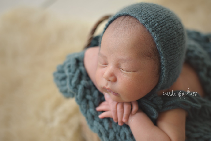 Tacoma newborn photographer muted teal hat knit wool rustic baby in bucket shadows inspiration