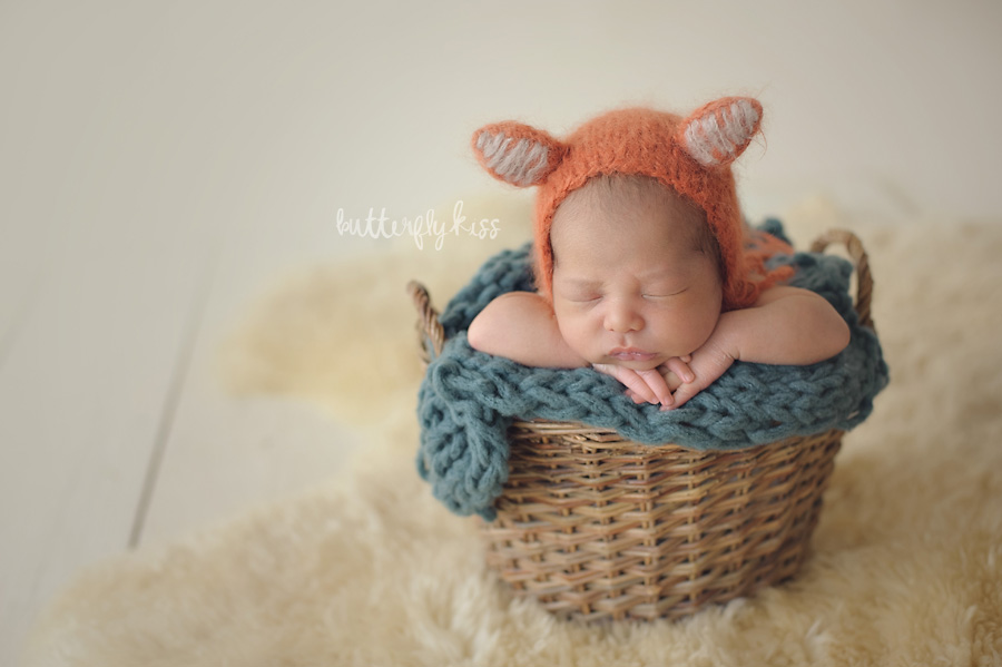 Tacoma newborn photographer muted teal hat knit wool rustic baby in bucket shadows fox hat inspiration