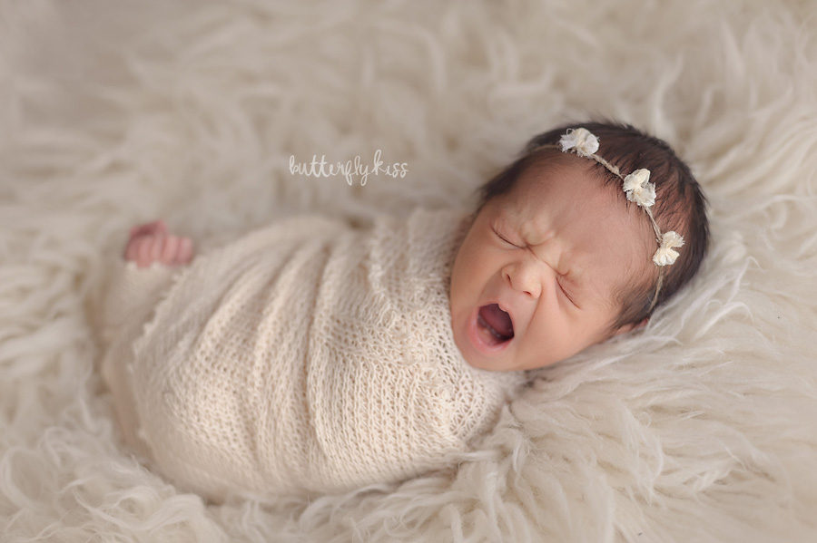 Tacoma newborn photographer native american baby session classic cream yawning baby