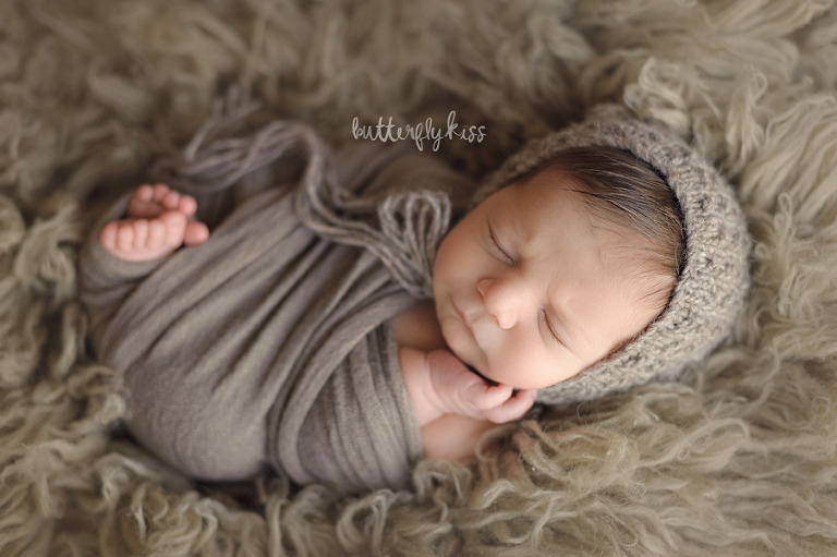Tacoma newborn photographer Adler wrapped toes peeking inspiration
