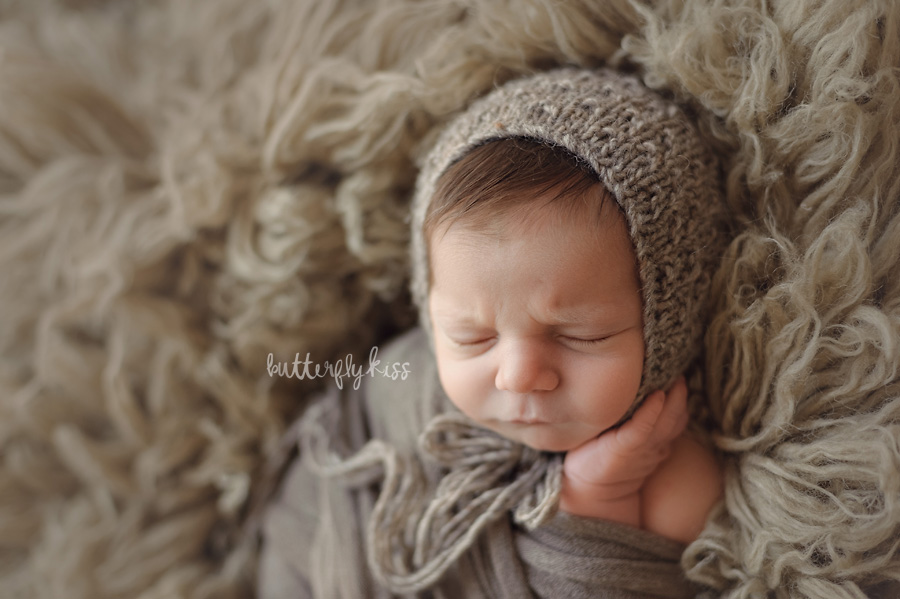 Tacoma newborn photographer Adler wrapped knit hat cozy baby