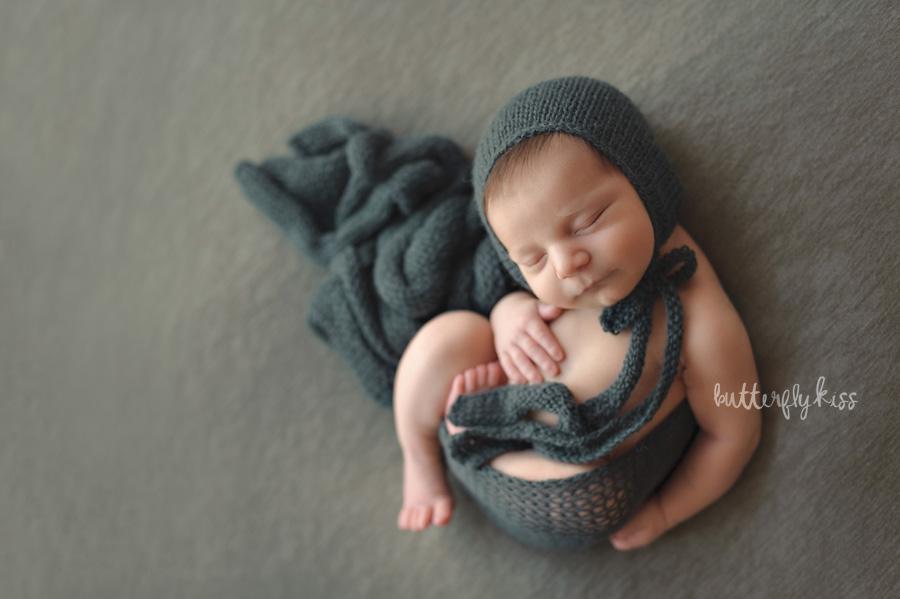 Tacoma newborn photographer Adler wrapped green tones matching hat